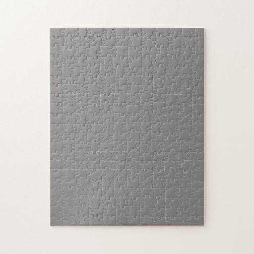 Rompecabezas con el fondo gris medio