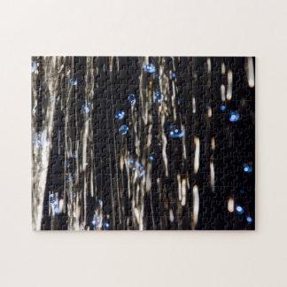 Rompecabezas de plata y azul de la lluvia