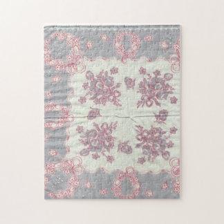 Rompecabezas gris y rosado del pañuelo