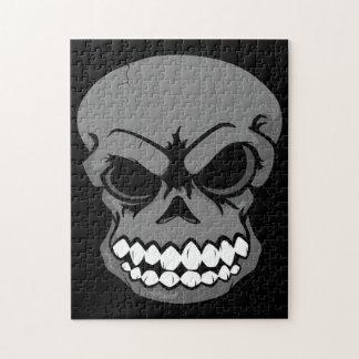 Rompecabezas negro del cráneo del vector