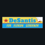 "Ron DeSantis Vote Florida Governor Bumper Sticker<br><div class=""desc"">Elect Ron DeSantis sticker for Governor of Florida in the 2018 Midterm.   Colorful,  Cheerful election gear to show Support for the GOP Congressman DeSantis.</div>"