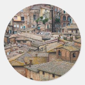 Roofs in Siena round sticker