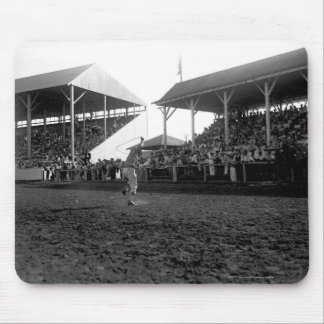 Roping tricks at a rodeo mouse pad