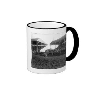Roping tricks at a rodeo coffee mug