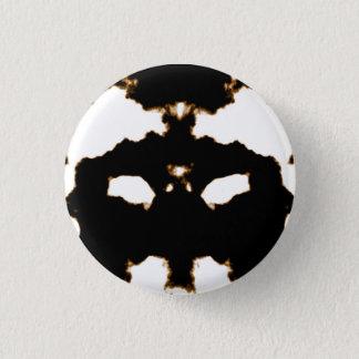 Rorschach Test of an Ink Blot Card on White Button