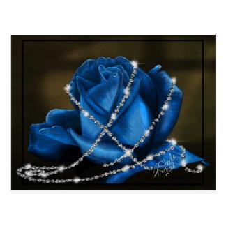 Rosa azul de la belleza envuelto en postal de los