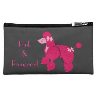 Rosa francés rosado del caniche y monedero cuidado