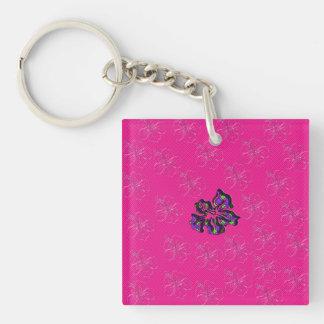 Rosa y flor floral púrpura del hibisco llaveros