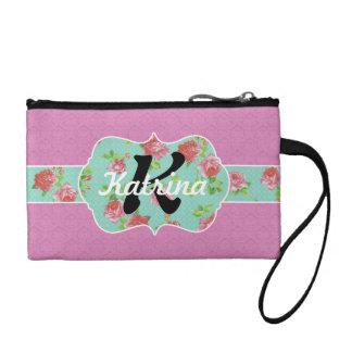 Rosa y monograma floral del trullo en el damasco