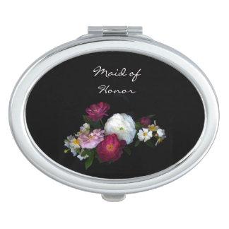 Rosas antiguos que casan a la criada del honor espejos de maquillaje
