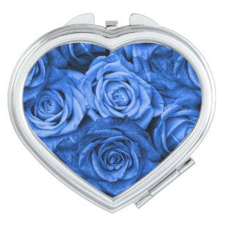 Rosas azules espejo maquillaje