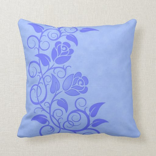 Rosas azules que remolinan almohada