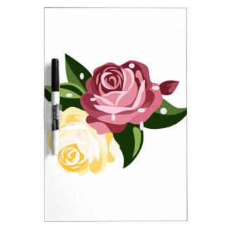Rosas con las gotas de agua pizarras