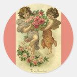 Rosas de los ángeles del Victorian del el día de Pegatina Redonda