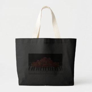 Rosas del teclado de piano y notas de la música bolsas lienzo