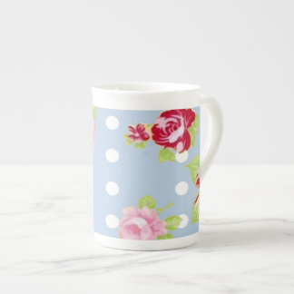 Rosas en la taza azul de la porcelana de hueso taza de porcelana
