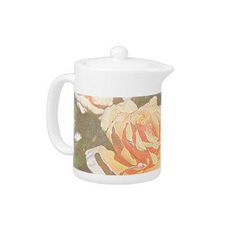 Rosas en pote del té de la floración