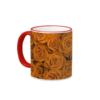Rosas espectaculares anaranjados tazas