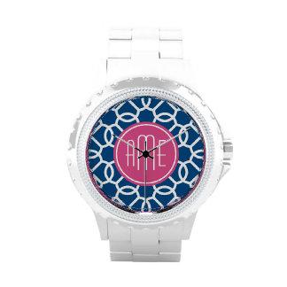 Rosas fuertes y monogramas geométricos azules del relojes de mano