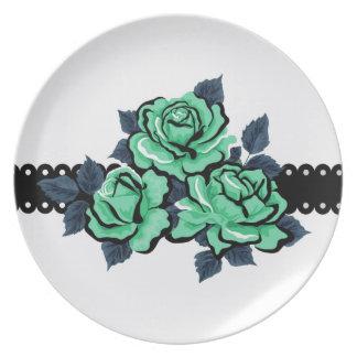 Rosas hermosos del color del trullo plato de comida