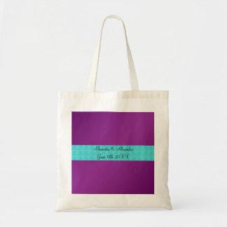 Rosas púrpuras de la turquesa que casan favores bolsa