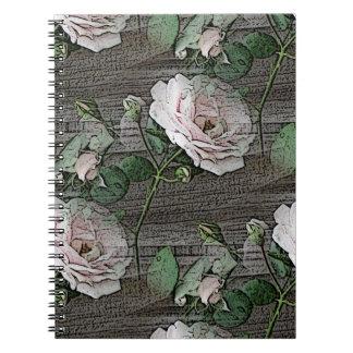 Rosas resistidos en la madera libretas