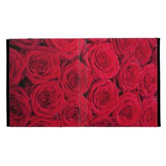 Rosas rojos con descensos del agua