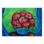 Rosas rojos en florero azul tarjeton