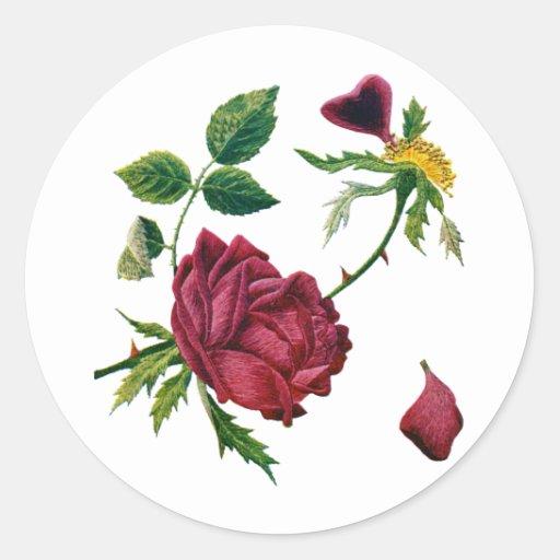 Rosas rojos hermosos hechos en bordado de la lana pegatina redonda