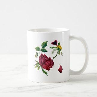 Rosas rojos hermosos hechos en bordado de la lana taza