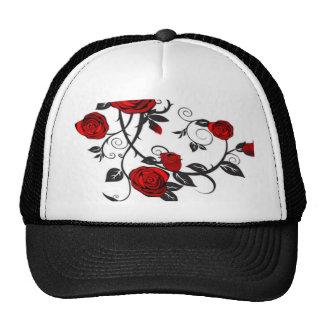 Rosas rojos que suben gorro de camionero