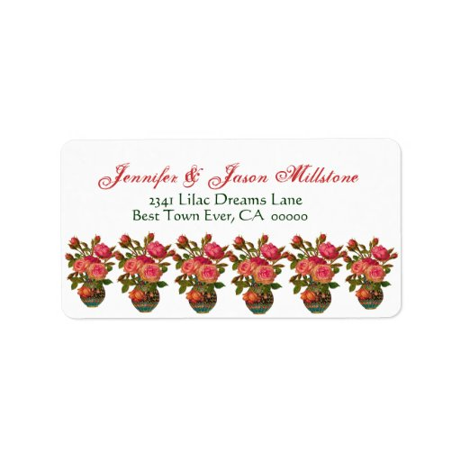 Rosas rosados del vintage en floreros que casan la etiqueta de dirección