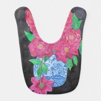 Rosas rosados en babero chino del florero