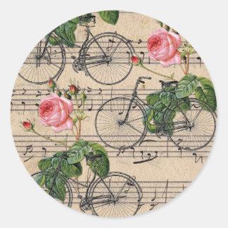 Rosas y bicicletas rosados del vintage pegatina redonda