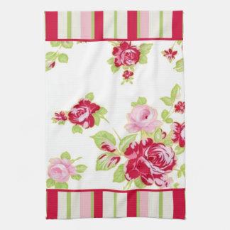 Rosas y toalla de cocina de las rayas