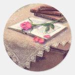 ROSE & BOOKS by SHARON SHARPE Round Sticker
