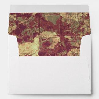 Rose camouflage pattern on tiled wall background envelope