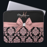 "Rose gold glitter Black Damask, Bow, Diamond Laptop Sleeve<br><div class=""desc"">Elegant, Rose gold glitter, Black Damask, Bow, diamond, Personalized, Name & Monogram design. Above black color block with name and monogram, at the middle a printed Peach Rose gold ribbon and bow with a shiny diamond. At the bottom Rosy Brown, Peach Rose gold glitter and black damask pattern. The font...</div>"