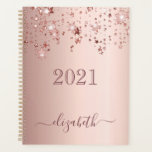 """Rose gold stars dripping glam girly luxury 2022 planner<br><div class=""""desc"""">A faux rose gold metallic looking background with elegant faux rose gold glittery and shining stars falling, dripping. Personalize and add a year 2021 and a name. The name is written in dark rose gold with a large modern hand lettered style script with swashes. To keep the swashes only delete...</div>"""