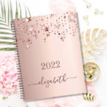"""Rose gold stars dripping monogram name girly 2022 planner<br><div class=""""desc"""">A faux rose gold metallic looking background with elegant faux rose gold glittery and shining stars falling, dripping. Personalize and add a year 2021 and a name. The name is written in dark rose gold with a large modern hand lettered style script with swashes. To keep the swashes only delete...</div>"""