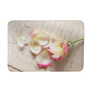 Rose on old copybook page bathroom mat