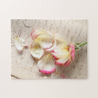 Rose on old copybook page jigsaw puzzle
