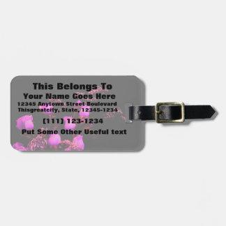 rose spray magenta against black tag for luggage