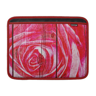 Rose superimposed on a grungy wood panel MacBook sleeve