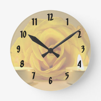 rose two candles bright yellow flower round clock