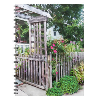 Roses on a Weathered Picket Fence Notebooks
