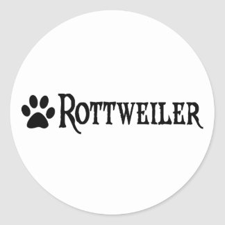 Rottweiler (estilo del pirata con el pawprint) pegatina redonda