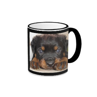 Rottweiler Puppy With Big Paws Lying Down Coffee Mugs