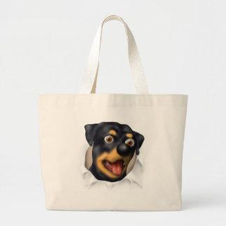 Rottweiler que revienta hacia fuera bolsas