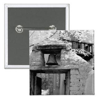 Rough adobe bell in entryway, Santa Fe, New Button